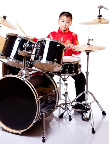Boy learning to play drums at National Academy of Music