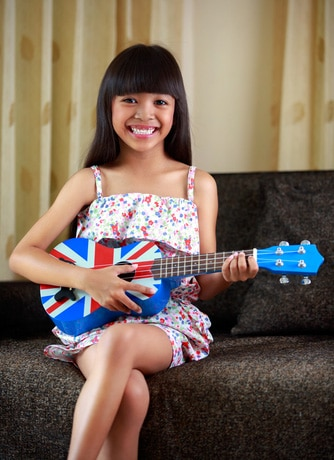 Girl playing ukulele